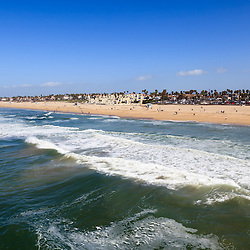 Photo of Huntington Beach in Orange County California. Huntington Beach is also known as Surf City USA and is a seaside beach city along the Pacific Ocean in Southern California.