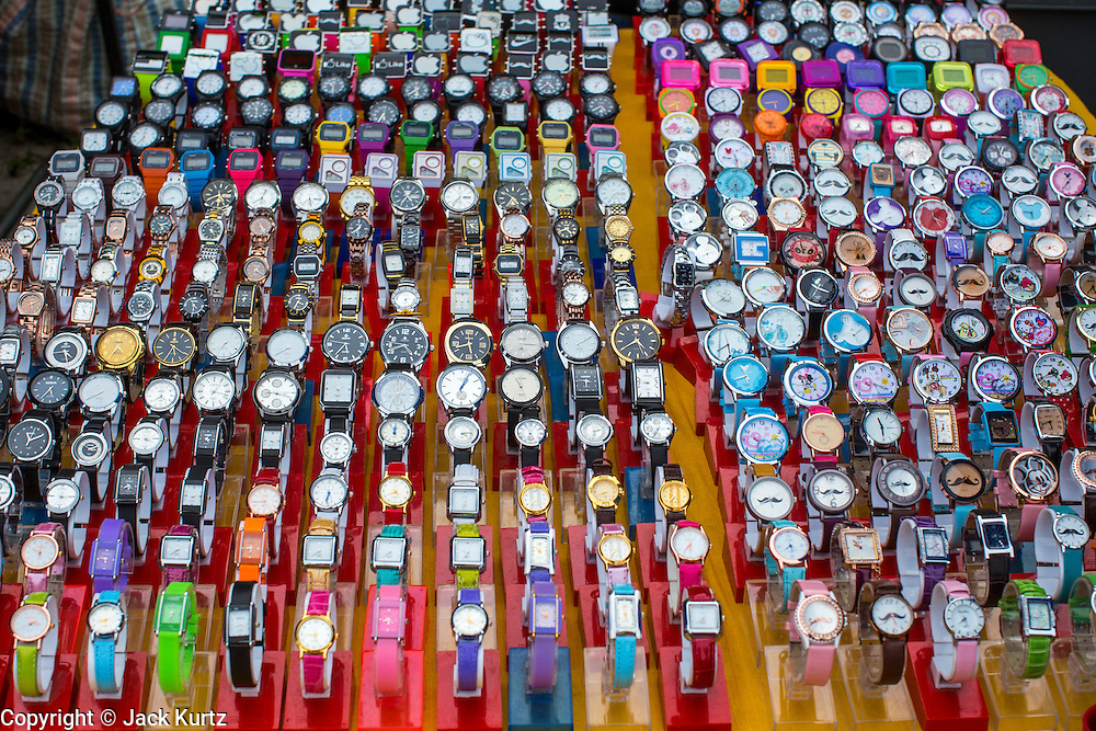 24 OCTOBER 2012 - PATTANI, PATTANI, THAILAND:  Watches for sale in a street market in Pattani, Thailand. More than 5,000 people have been killed and over 9,000 hurt in more than 11,000 incidents, or about 3.5 a day, in Thailand's three southernmost provinces and four districts of Songkhla since the insurgent violence erupted in January 2004, according to Deep South Watch, an independent research organization that monitors violence in Thailand's deep south region that borders Malaysia. Muslim extremists are battling the Thai government and its symbols, like schools and Buddhist facilities.    PHOTO BY JACK KURTZ