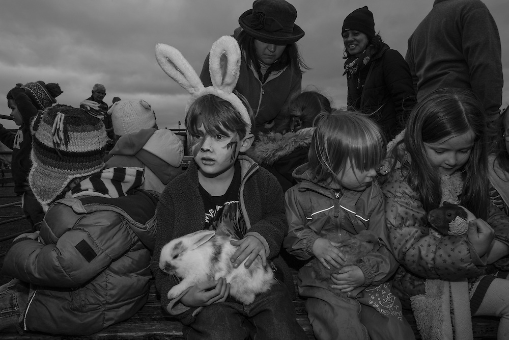 Ben holds a bunny at the petting zoo during the Bunny Hop Easter school fair in Berkhamsted, England Saturday, March 19, 2016 (Elizabeth Dalziel) #thesecretlifeofmothers #bringinguptheboys #dailylife
