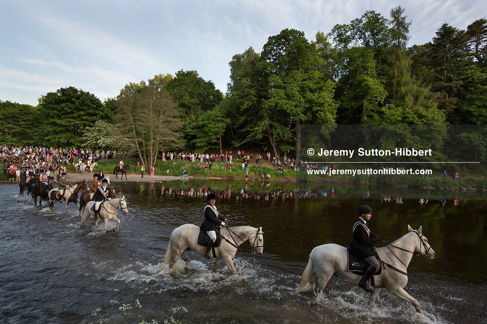 Viewing the horses crossing the River Tweed during the Riding of the Marches, at The Peebles Beltane Festival, including their Common Riding of the Marches, with Cornet Daniel Williamson, and Cornets Elect Lass Susan Thomson, in Peebles, Scotland, Wednesday 19th June 2013. <br /> N55&deg;39.057'<br /> W3&deg;12.395'