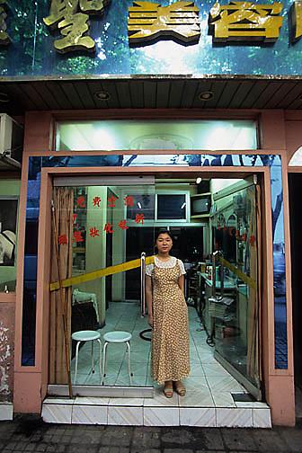 China, Cities, Shop clerk at hair salon in Shanghai, China
