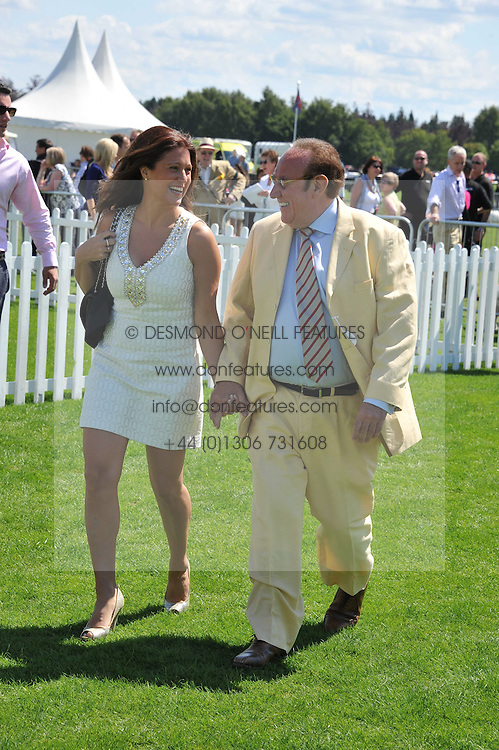 ANDREW NEIL and SUSAN NILSSON at the 27th annual Cartier International Polo Day featuring the 100th Coronation Cup between England and Brazil held at Guards Polo Club, Windsor Great Park, Berkshire on 24th July 2011.