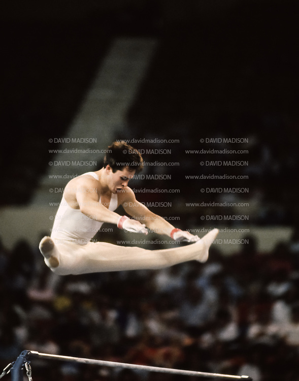 PHOENIX - APRIL 24:  Dimitri Belozerchev of the USSR competes on the high bar during a USA - USSR gymnastics meet on April 24, 1988  at the Arizona Veterans Memorial Coliseum in Phoenix, Arizona.  (Photo by David Madison/Getty Images)
