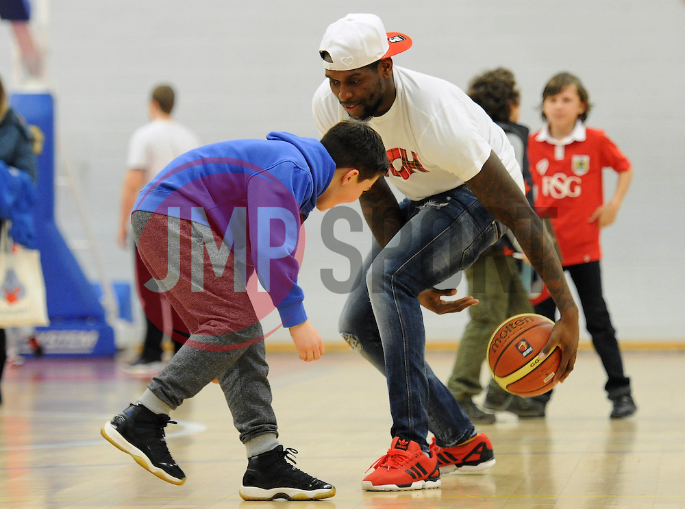 Jay Emmanuel-Thomas plays basketball with a fan - Photo mandatory by-line: Dougie Allward/JMP - Mobile: 07966 386802 - 27/02/2015 - SPORT - basketball - Bristol - SGS Wise Campus - Bristol Flyers v Leeds Force - British Basketball League