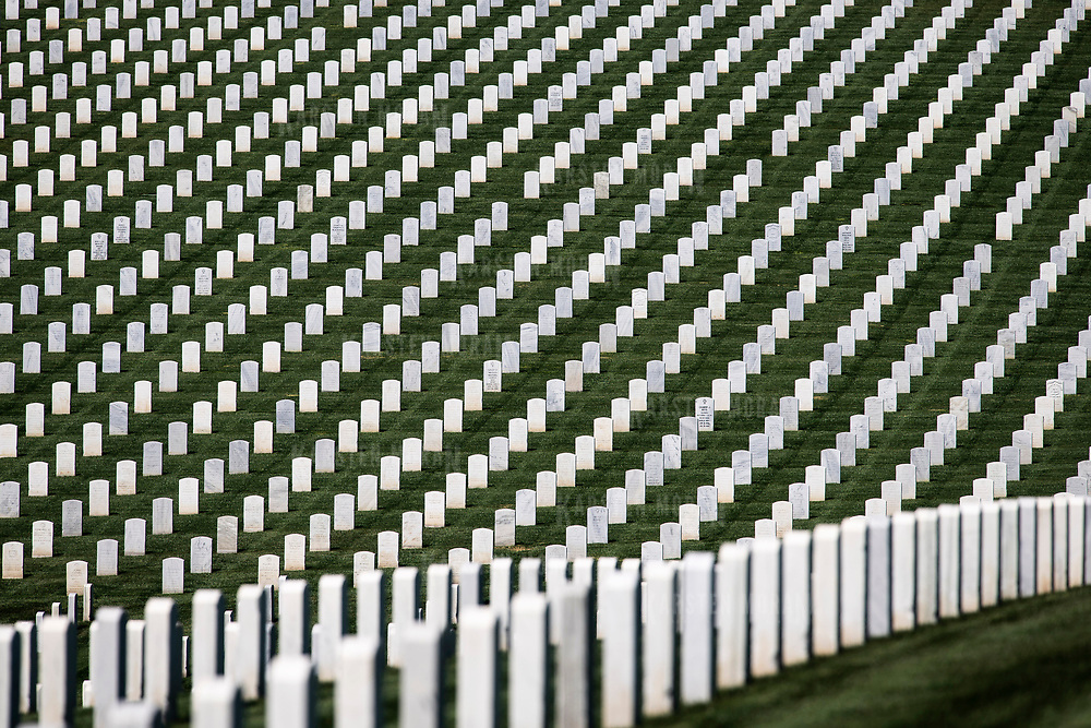 March 19, 2018 - San Diego, Calif. : Stark white tombstones rise up along a hillside in Fort Rosecrans National Cemetery in San Diego, California. CREDIT: Karsten Moran / Redux