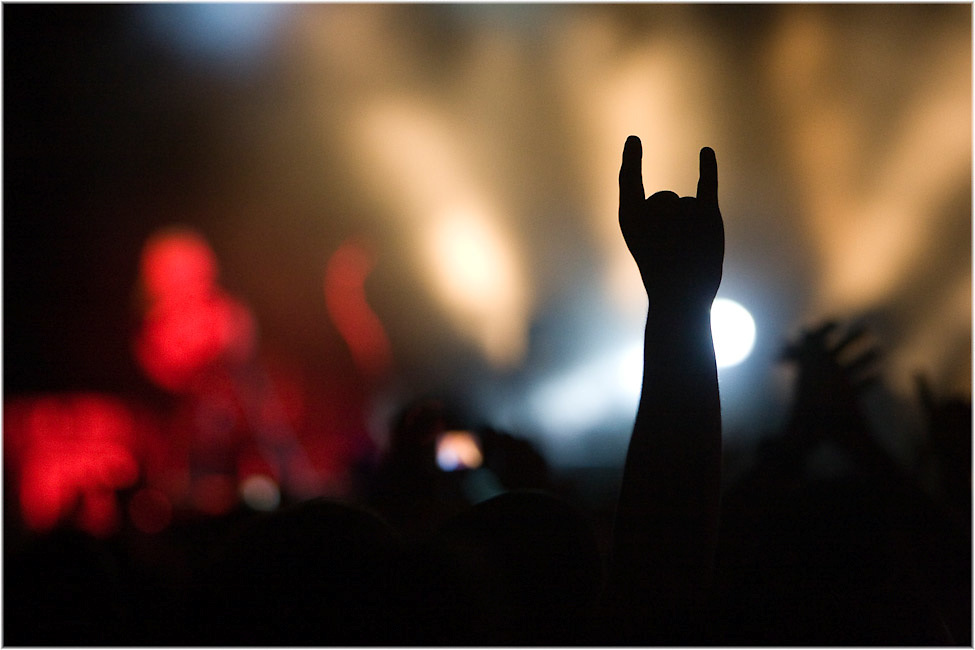 A heavy metal fan throws his horns in the air as Motley Crue perfom during the HeavyMTL festival in Montreal. PHOTO BY TIM SNOW