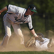 St. Marks Infielder John Panico (12) tags Caravel Academy Bradley Kaden attempting to steal second base during a regular season baseball game between the St. Marks Spartans and Caravel Academy at St. Marks Stadium Thursday April 14, 2016 in Wilmington.