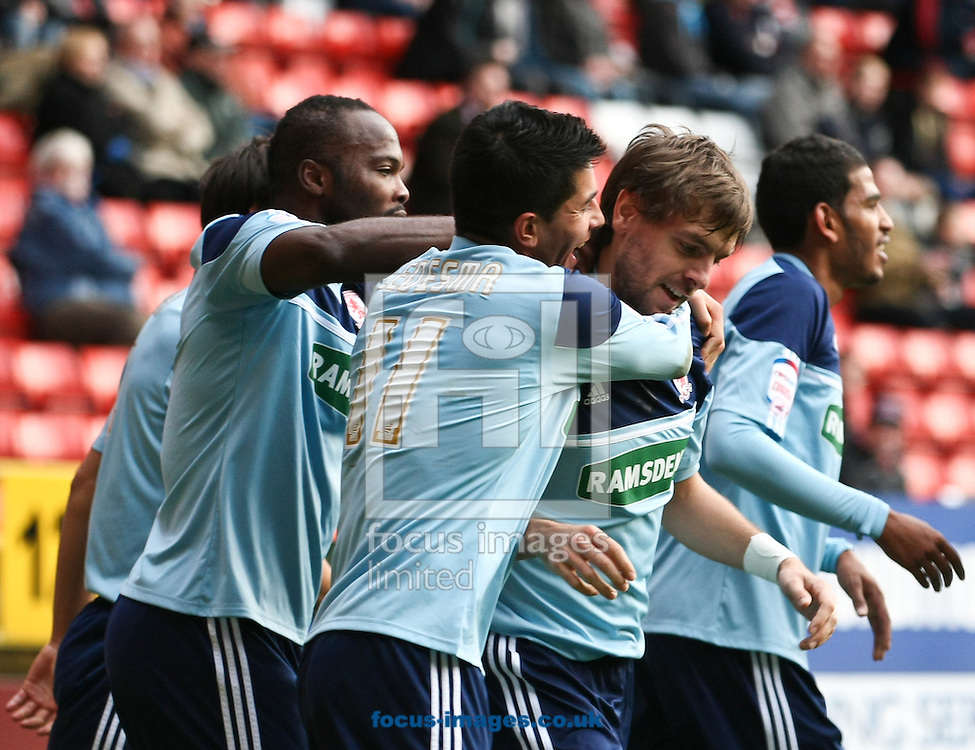 Picture by David Horn/Focus Images Ltd +44 7545 970036.03/11/2012.Jonathan Woodgate of Middlesbrough is congratulated by team mates on scoring the equalising goal during the npower Championship match at The Valley, London.
