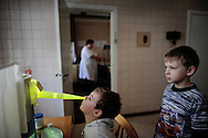 On April 26 - 2011.25 years after the Chernobyl disaster people are still suffering from the long term consequences of a nuclear meltdown. Countries affected struggle with cronic illness, contaminated food - For many their life ended with Chernobyl...<br /> Boys going thru medical treatment at The Ukrainian scienticfic centre of Radiation medecine.. more than 60 children are constantly admitted to the ward to receive treatment for their bad helath due to the disaster 25 years ago. lung infections and respiration problems are often seen together with even more severe cancer illnesses.