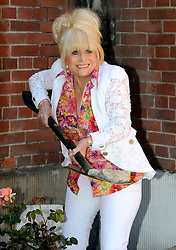 Barbara Windsor with a rose name after her at the launch of  an appeal to repair the gardens at St.Paul's Church in Covent Garden London, Friday, 25th May 2012.  Photo by: Chris Joseph / i-Images