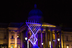 © Licensed to London News Pictures. 16/12/2014. London, UK. The Menorah is seen in front of the National Gallery during the Chanukah Ceremony in Trafalgar Square, London to celebrate Chanukah (Hanukkah), the eight-day Jewish Festival of Lights. Photo credit : Vickie Flores/LNP