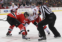 Feb 16; Newark, NJ, USA; New Jersey Devils center Travis Zajac (19) and Carolina Hurricanes center Brandon Sutter (16) face off during the first period at the Prudential Center.
