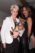 Surfer Keala Kennelly, dog Coco Chanel, and Nikki di Santo