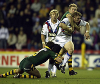Photo. Aidan Ellis.<br />Great Britan v Australia.<br />1st Test Match at JJb Stadium Wigan.<br />8/11/2003.<br />Great Britain's Mike Forshaw is tackled by the Australian defence