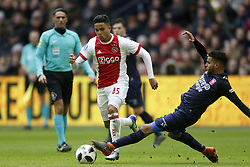 (L-R), Justin Kluivert of Ajax, Adam Maher of FC Twente during the Dutch Eredivisie match between Ajax Amsterdam and FC Twente Enschede at the Amsterdam Arena on February 11, 2018 in Amsterdam, The Netherlands