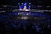 LAS VEGAS, NV - AUGUST 26:  A general view shows singer/songwriter Demi Lovato performing the American national anthem prior to the super welterweight boxing match between Floyd Mayweather Jr. and Conor McGregor on August 26, 2017 at T-Mobile Arena in Las Vegas, Nevada. (Photo by Jeff Bottari/Zuffa LLC/Zuffa LLC via Getty Images)