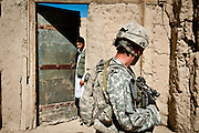 An Afghan man leers at a passing American soldier in the Nerkh Valley of Wardak Province.