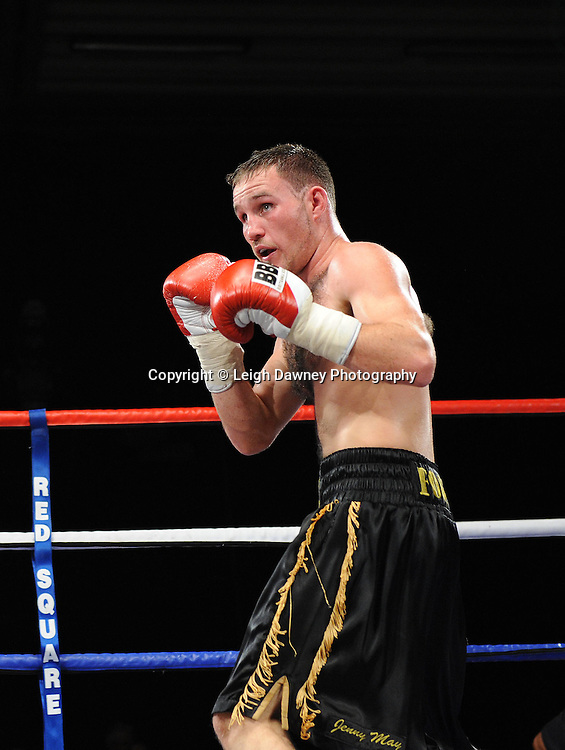 Glen Foot (black shorts) defeats William Warburton in a Welterweight  contest at the Doncaster Dome, Doncaster, Uk, 3rd September 2011. Frank Maloney Promotions. Photo credit: Leigh Dawney 2011