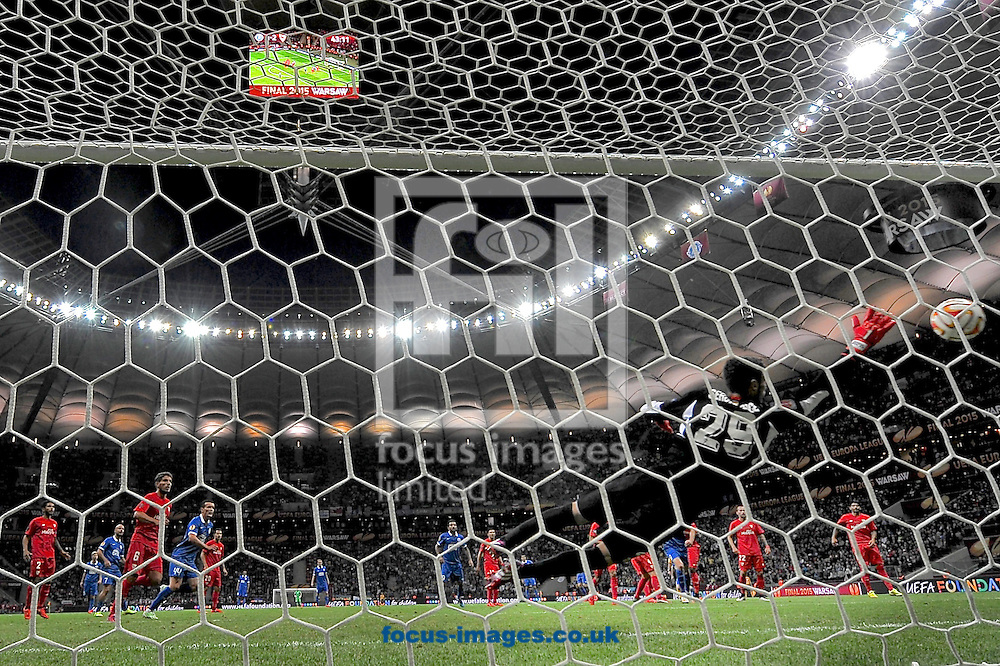 Sevilla goalkeeper Sergio Rico is beaten as Ruslan Rotan of Dnipro Dnipropetrovsk  scores their second goal to make it Dnipro Dnipropetrovsk  2 Sevilla 2 during the UEFA Europa League final at National Stadium, Warsaw<br /> Picture by Ian Wadkins/Focus Images Ltd +44 7877 568959<br /> 27/05/2015