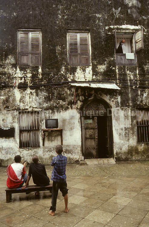 Watching TV in the street, Stone Town, Zanzibar