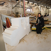 "VENICE, ITALY - JUNE 02:  Artist Reem Al Ghaith poses within her installation ""What's left of her land"" inside the United Arab Emirates pavillion on June 2, 2011 in Venice, Italy. This year's Biennale is the 54th edition and will run from June 4th until 27 November."
