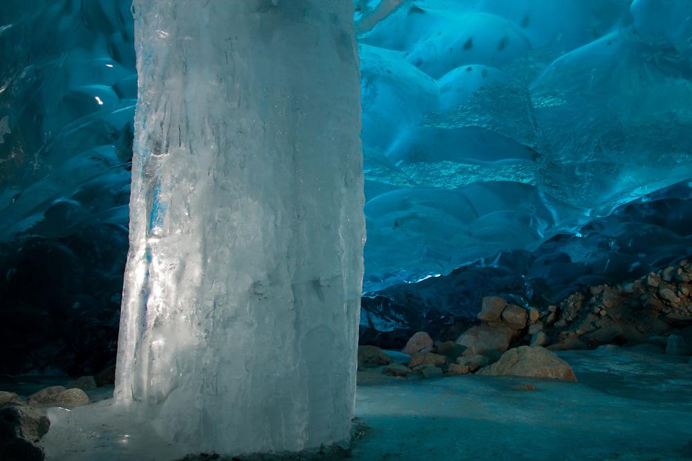 An illuminate ice column within the blue ice cave beneath the Mendenhall Glacier.