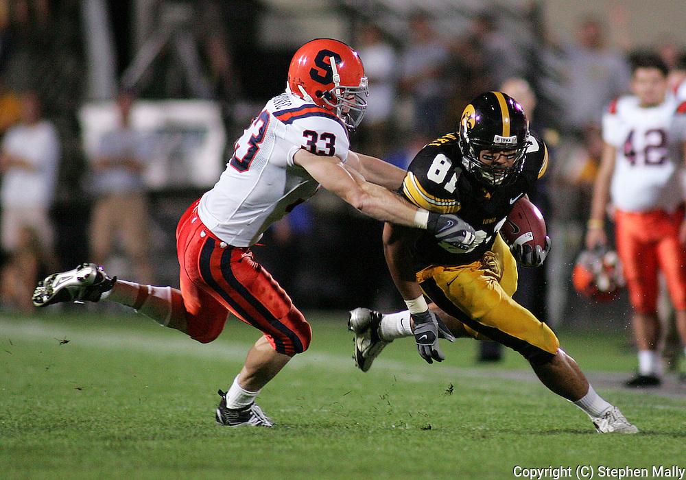 08 SEPTEMBER 2007: Iowa tight end Tony Moeaki (81) tries to run away from Syracuse linebacker Ben Maljovec (33) in Iowa's 35-0 win over Syracuse at Kinnick Stadium in Iowa City, Iowa on September 8, 2007.