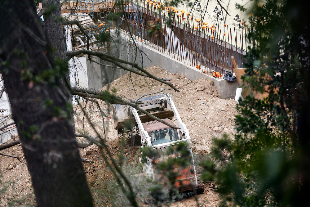 A crew uses a bobcat dozer to move dirt at the mansion of Mohamed Hadid at 901 Strada Vecchia in the Bel Air neighborhood on Monday, July 20, 2015 in Los Angeles, California. Photo by Patrick T. Fallon for DailyMail.com