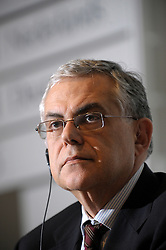 Lucas D. Papademos, vice president of the European Central Bank, listens during a news conference at the National Bank of Belgium, in Brussels, Thurdsday, Dec. 4, 2008. (Photo © Jock Fistick)..