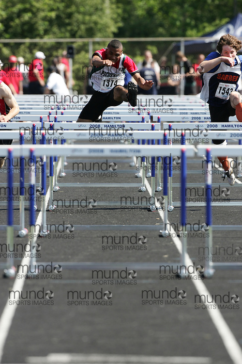 Hamilton, Ontario ---06/06/08--- Preston Farrell of Pickering in Ajax competes in the sprint hurdles at the 2008 OFSAA Track and Field meet in Hamilton, Ontario..
