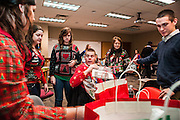 Megan Baird, Patrick Burke, Christie Boening, Andrea Schaaf, and Jared Dudas, freshmen, reach for presents to play Secret Santa during The College of Business Honors Program's Christmas party in Copeland Hall on Wednesday, December 5, 2012.
