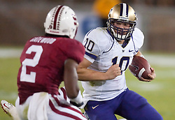 September 26, 2009; Stanford, CA, USA;  Washington Huskies quarterback Jake Locker (10) rushes toward Stanford Cardinal cornerback Corey Gatewood (2) in the fourth quarter at Stanford Stadium. Stanford won 34-14.