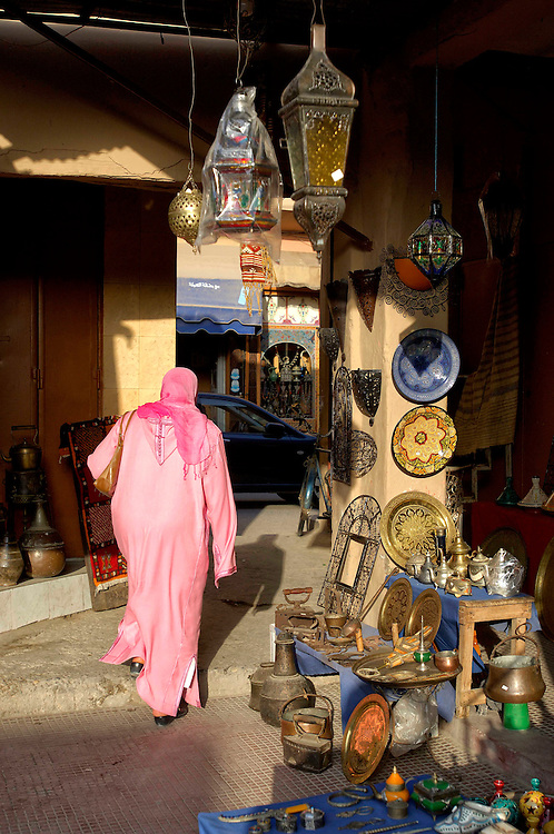woman walking veiled in Souq, Taroudant, Morocco