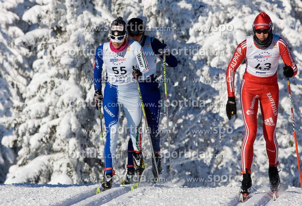 Elisa Brocard (ITA) and Ursina Andersson (SWE) at Ladies 15 km Classic Mass Start Competition of Viessmann Cross Country FIS World Cup Rogla 2009, on December 20, 2009, in Rogla, Slovenia. (Photo by Vid Ponikvar / Sportida)