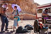 People talking outside a mobile home at Middle East Tek, Wadi Rum, Jordan, 2008