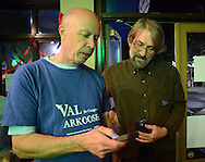 JENKINTOWN, PA - MAY 20:  Glen Carlson (L) and Bill England, supporters of 13th Congressional Democratic candidate Dr. Valerie Arkoosh check campaign results online at the West Avenue Grill  May 20, 2014 in Jenkintown, Pennsylvania. (Photo by William Thomas Cain/Cain Images)