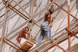 Construction workers in Havana Cuba; working on the restoration of the Fine Art Museum  Museo de Bellas Artes,