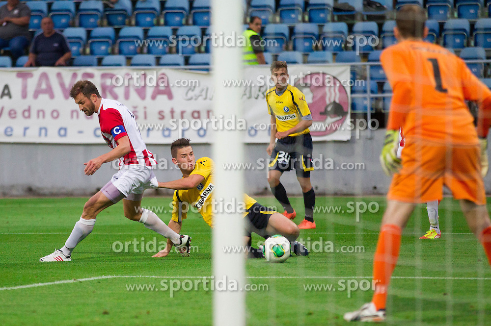 Miika Koppinen #7 of Tromso vs Benjamin Verbic #7 of NK Celje during football match between NK Celje (SLO) and Tromso Il (NOR) in 2nd Leg of 1st Round of Europa League on July 11, 2013 in Arena Petrol, Celje, Slovenia. (Photo by Vid Ponikvar / Sportida.com)