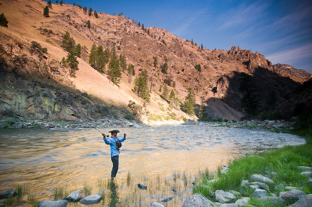 Idaho. Middle Fork Salmon River. Fly fisherman at sunrise while on rafting trip. MR