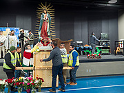 11 DECEMBER 2019 - DES MOINES, IOWA: Men carry the statue of the Virgin of Guadalupe during the Virgin of Guadalupe celebration at Our Lady of the Americas Catholic Church in Des Moines. Virgin of Guadalupe Day is one of the most important holy days in Mexican Catholicism. It marks Dec. 12, 1531, the day Juan Diego, an indigenous Mexican peasant, saw an apparition of the Virgin Mary on a barren hillside in what is now Mexico City. A basilica was built on the site. Virgin of Guadalupe Day is celebrated throughout Mexico and in Mexican communities in the United States.                PHOTO BY JACK KURTZ
