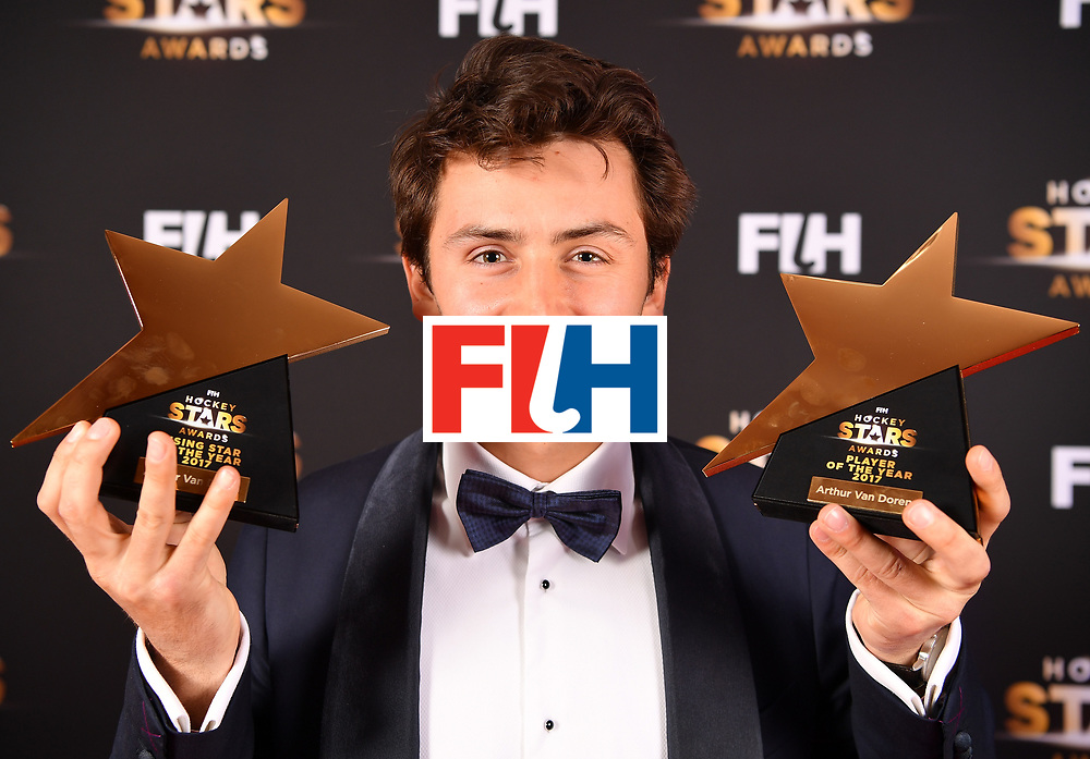 BERLIN, GERMANY - FEBRUARY 05:  Arthur van Doren  of Belgium holds his awards for player of the year and rising star during the Hockey Star Awards night at Stilwerk on February 5, 2018 in Berlin, Germany.  (Photo by Stuart Franklin/Getty Images For FIH)