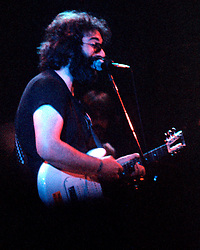 Jerry Garcia performing with The Grateful Dead. Live in Concert at The Springfield Civic Center on 23 April 1977. Solo Shot in Bright Blue Light.