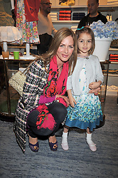 TRINNY WOODALL and her daughter LYLA ELICHAOFF at 'Paint Your Polo Celebration' a children's party in aid of the charity Clic Sargent held at Ralph Lauren, 139/141 Fulham Road, London on 28th April 2009.