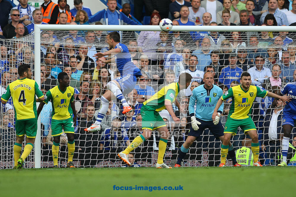John Terry of Chelsea heads for goal during the Barclays Premier League match at Stamford Bridge, London<br /> Picture by Paul Chesterton/Focus Images Ltd +44 7904 640267<br /> 04/05/2014