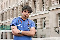 Portrait of an Indian male doctor standing with arms crossed