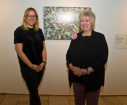 Pictured: Scottish Parliament Deputy Presiding Officer Christine Grahame and Sanne Schim van der Loeff of World Press Photo <br /> Scottish Parliament Deputy Presiding Officer Christine Grahame, Sanne Schim van der Loeff of World Press Photo, and photographer Tom Stoddart were on hand as the World Press Photo exhibition was launched at the Scottish Parliament today.<br /> Ger Harley | EEm 3 August  2017