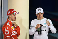 Valtteri Bottas of Mercedes AMG Petronas, with Sebastian Vettel of Scuderia Ferrari, after winning his maiden pole position during the Bahrain Formula One Grand Prix Qualifying session at the International Circuit, Sakhir<br /> Picture by EXPA Pictures/Focus Images Ltd 07814482222<br /> 15/04/2017<br /> *** UK &amp; IRELAND ONLY ***<br /> <br /> EXPA-EIB-170415-0333.jpg
