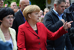 04.06.2013, Greiz, GER, Bundeskanzlerin Angela Merkel besucht Hochwassergebiet in Thueringen, im Bild Bundeskanzlerin Angela MERKEL (CDU) // during visits flood area of German Chancellor Angela Merkel at Greiz, Germany on 2013/04/06. EXPA Pictures © 2013, PhotoCredit: EXPA/ Eibner/ Bert Harzer<br /> <br /> ***** ATTENTION - OUT OF GER *****