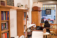 5 November, 2008. New York, NY. Podunk is a self-styled &quot;American tearoom&quot; in the East Village.The owner, Elspeth Treadwell, left a career in publishing to open Podunk six years ago, in 2002. The interior of the tearoom includes country-decor bookshelves, a wooden sled, benches and garden chairs.<br /> <br /> &copy;2008 Gianni Cipriano for The New York Times<br /> cell. +1 646 465 2168 (USA)<br /> cell. +1 328 567 7923 (Italy)<br /> gianni@giannicipriano.com<br /> www.giannicipriano.com