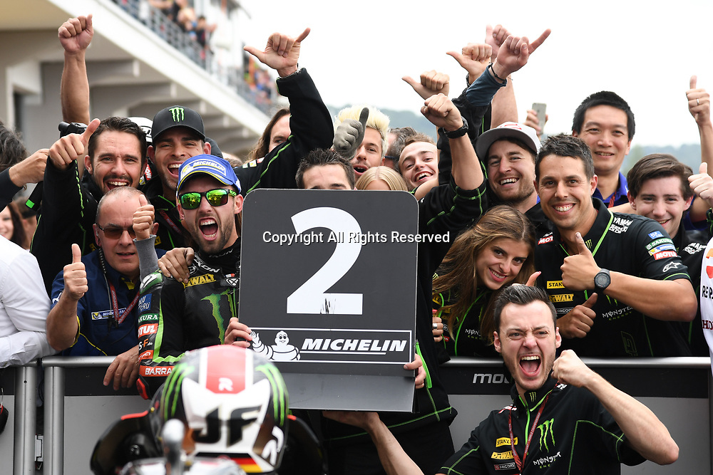 July 2nd 2017, Sachsenring Circuit, Oberlungwitz, Germany; MotoGP Grand Prix of Germany;  Jonas Folger with his technical team celebrate their 2nd placed finish at parc ferme